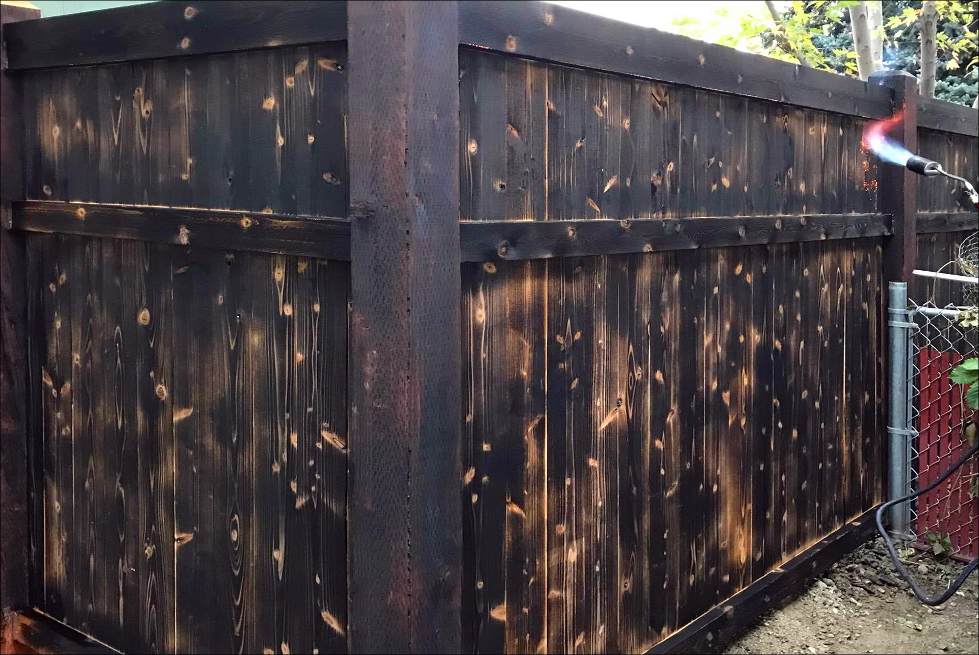 Custom Wood Fence With Dark Burnt Textures johnson Construction Billings