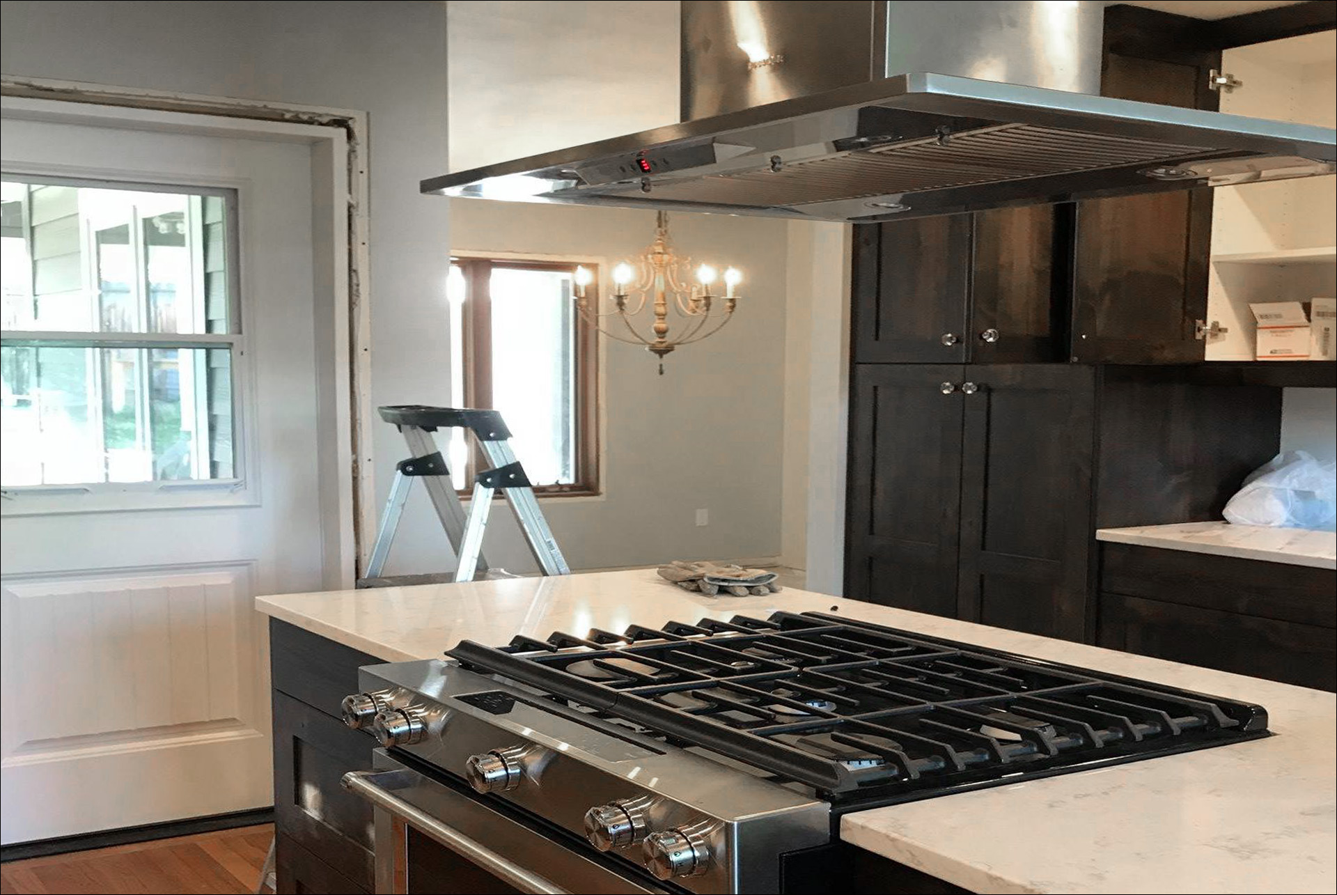 Kitchen Remodel Dark Wood Cabinets White Marble Countertops Range in Island 1